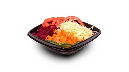 Fresh and delicious salad with red vegetables, tomatoes cabbage carrot and beets on a white background