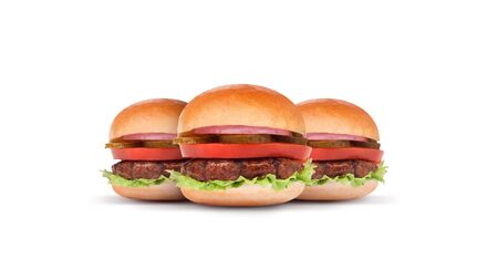 Close up juicy and fresh mini burgers with tomato fresh lettuce and onions on white background Stock Photo