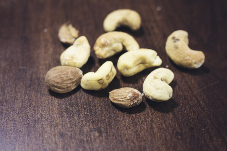 close-up mix of almond and cashew on wood table Stock Photo