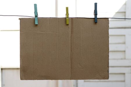 metal line hold an cardboard with colorful clothespins