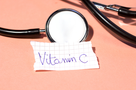 vitamin c on small paper with stethoscope Stock Photo