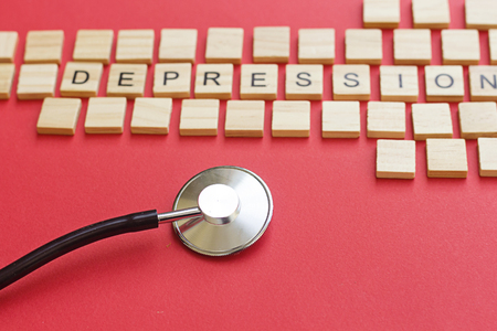 depression concept with wooden letters and stethoscope Stock Photo