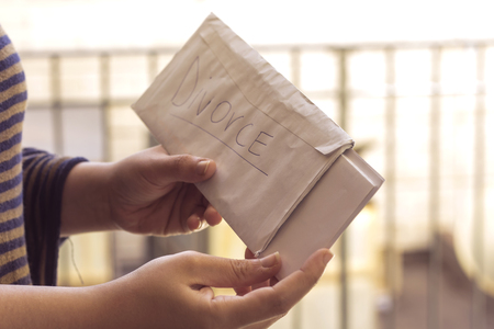 muslim hand woman receive divorce  envelope Stock Photo