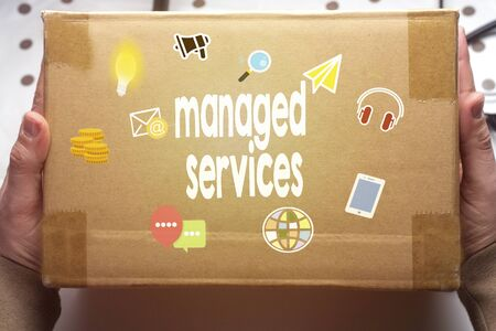 Managed services concept painting on carton box