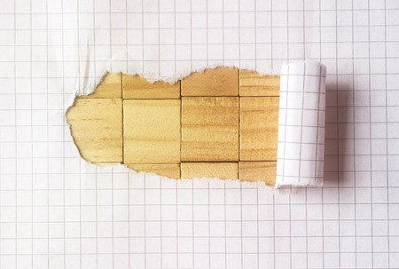 Paper tear on cube wood background