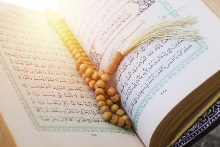 rosary and holy quran book on wood stand Stock Photo