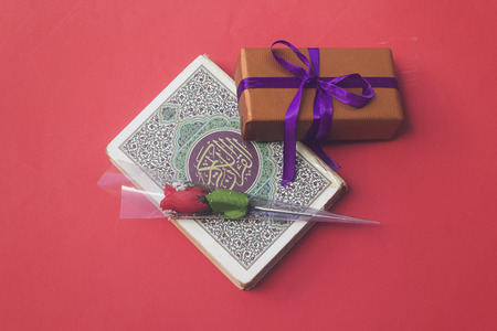 holy book of Muslims quran and present, rose flower for muslim holiday