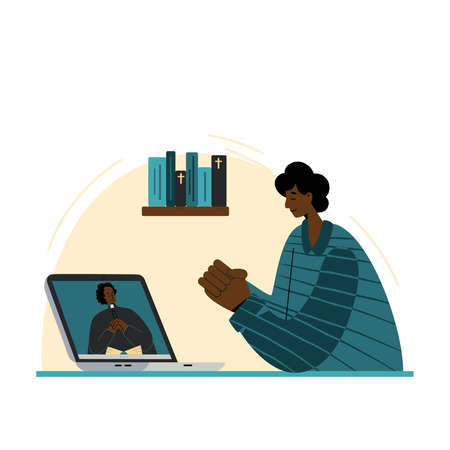 The pastor conducts church services online. Concept Church and Liturgy online. African American man prays in front of a laptop.Protestant priest is african american man. Internet Church.