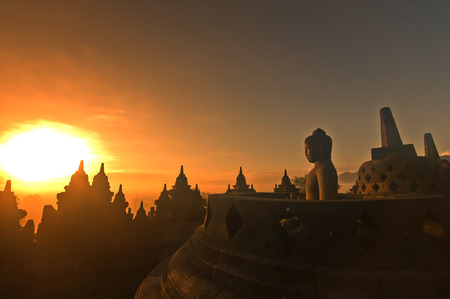 Morning silhouette of Buddha image on  Borobudur temple,Yogyakarta. Java, Indonesia.