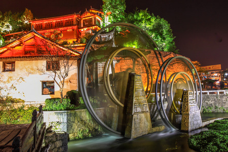 Watermill in Lijiang, Yunnan, China.It is the Lijiang old town signs.