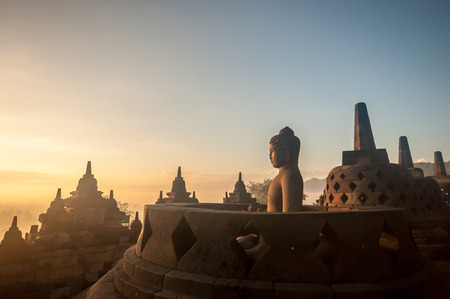 Borobudur Temple at sunrise, Yogyakarta, Java, Indonesia. (silhouette scene) Фото со стока - 34461487