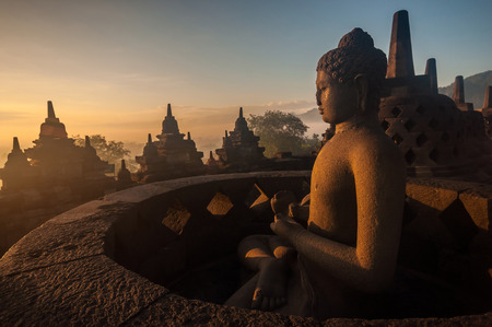 Borobudur Temple at sunrise, Yogyakarta, Java, Indonesia. (silhouette scene) Фото со стока