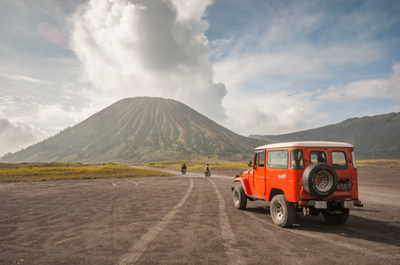 Java,Indonesia-Arpil 25,2010 : Tourists 4x4 Jeep for tourist rent at Mount Bromo,The active Mount Bromo is one of the most visited tourist attractions in East Java , Indonesia. Zdjęcie Seryjne - 35780573