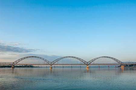 upstream: The new Sagaing Bridge is also called Yadanabon Bridge. It lies at a place about 2000ft 610m upstream of Inwa Bridge. Stock Photo