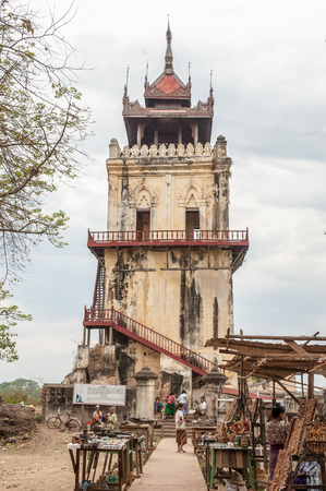 watch city: InwaMyanmarMarch 162011 : Tourist visit Nanmyint watch tower one of the famous travel destinationbuilt in 1822 and 90ft 30m high  in Inwa or Ava ancient city Mandalay Myanmar.