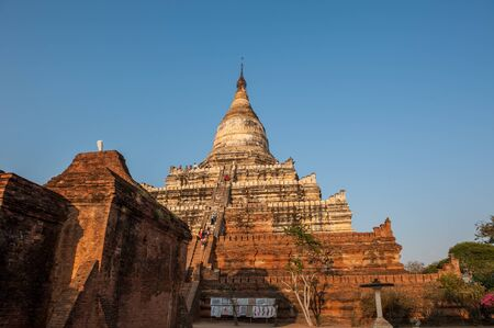 fascinate: BaganMyanmarMarch  : Unidentify tourists climb to top of the Shwesandaw pagoda to see the sunset in Bagan of Myanmar.Shwesandaw Pagoda was built by King Anawrahta during the late 11th Century.