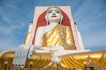 buit in: The Kyeik Pun Pagoda in Bago , Myanmar. This pagoda has four giant Buddha statues facing the four points of the compass,buit by King Dhammazedi in A.D. 1476, are 27 meters height.