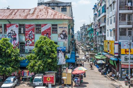 bedraggled: Yangon, Myanmar - March 24,2011: View of housing blocks in down toen the city of Yangon, Myanmar. Yangon is the biggest city in Myanmar with population over 4 million people.