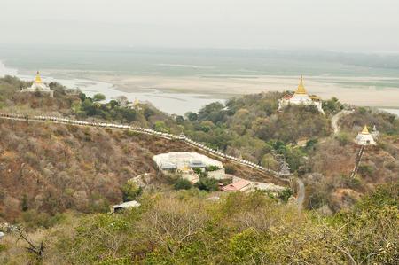 banian tree: Golden pagoda in sagaing hill, Mandalay, myanmar.