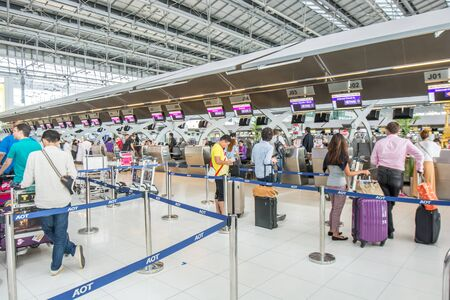 Bangkok,Thailand-August 31,2014 : Passengers arrive at check in desk  in Suvarnabhumi Airport  in Bangkok ,Thailand.This airport is handling about 45 million passengers annually.