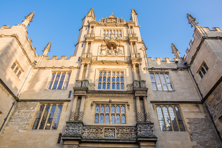 old english: Oxford, UK - December 20, 2016 : View of historic university of Oxford, England. Oxford is known as the home of the University of Oxford.