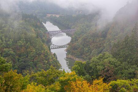 First bridge and Tadami river in beautiful autumn season in Japan
