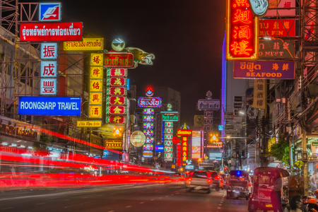 Chinatown, Bangkok, Thailand - March 31 , 2015: Night light trails  neon board signs shops on Yaowarat road, Chinatown with  Chinese buildings, restaurants and decoration in  Bangkok,Thailand. 新聞圖片