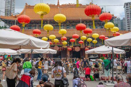 Hong kong - May 5,2018 : The Buddhist people and tourist visiting Wong Tai Sin Temple (also called Sik Sik Yuen Chinese temple), Hong Kong. Sajtókép
