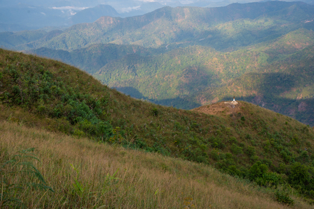 Mountain landscape view and white pagoda located in northern of Thailand Фото со стока