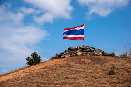 Flag of Thailand. Image of waving Thai flag of Thailand with blue sky and mountain