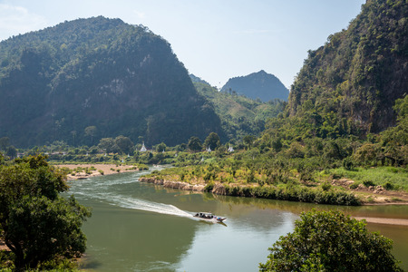 Mountain landscape view with river boat and white pagodas located in northern of Thailand