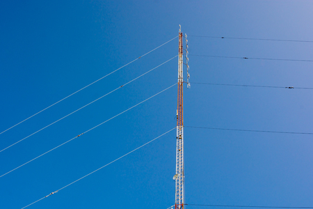 Communications tower with blue Cloud sky background