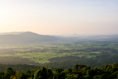 Beautiful scenery during sunrise time with mountain and savannah field in Thailand Фото со стока - 121934054