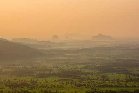Beautiful scenery during sunrise time with mountain and savannah field in Thailand Фото со стока - 121934137