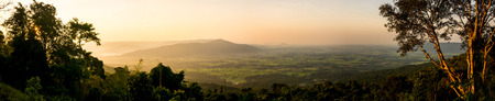 Beautiful panorama scenery during sunrise time with mountain and savannah field in Thailand