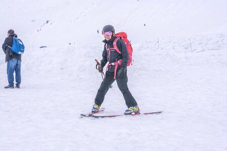 Tateyama, Japan - April 21, 2019 : Unidentified tourists visiting snow corridor on Tateyama Kurobe Alpine Route, Japanese Alp in Tateyama, Japan. Zdjęcie Seryjne - 135906779