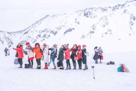 Tateyama, Japan - April 21, 2019 : Unidentified tourists visiting snow corridor on Tateyama Kurobe Alpine Route, Japanese Alp in Tateyama, Japan. Zdjęcie Seryjne - 135906783