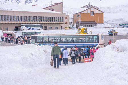 Tateyama, Japan - April 21, 2019 : Unidentified tourists visiting snow corridor on Tateyama Kurobe Alpine Route, Japanese Alp in Tateyama, Japan. Zdjęcie Seryjne - 135906784