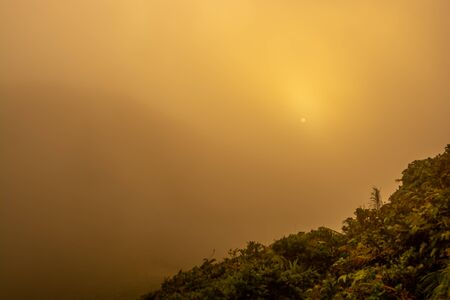 Beautiful sunset in foggy mountains landscape in southern of Thailand Zdjęcie Seryjne