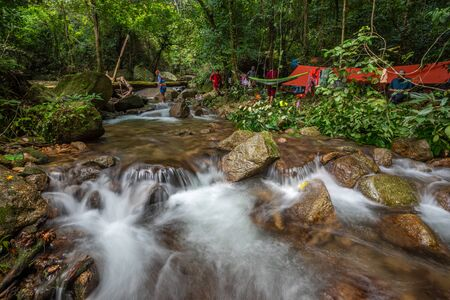 Phatthalung, Thailand-December  29, 2019: The trekkers camping  in green forest river stream in jungle of Phatthalung, Thailand.