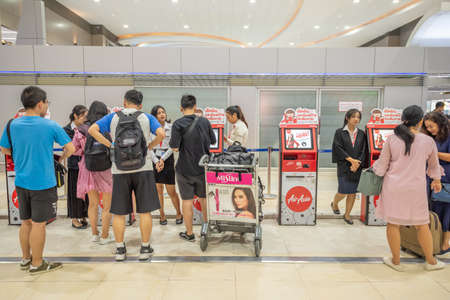 Bangkok,Thailand - April 04,2019 : Interior with passenger check in at Airasia check in machine in Don Mueang International Airport, Bangkok. Publikacyjne