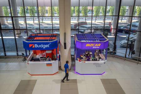 Bangkok, Thailand - April 04,2019 : The rent a car desk at arrival terminal of  Don Mueang International Airport.