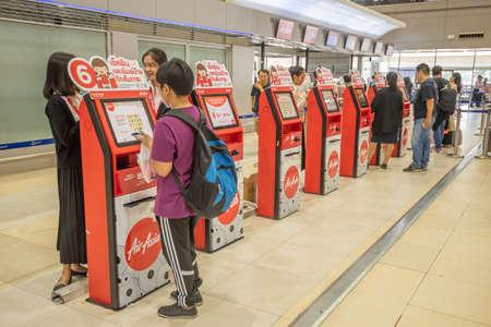 Bangkok, Thailand - April 04, 2019 : Interior with passenger check in at Airasia check in machine in Don Mueang International Airport, Bangkok.