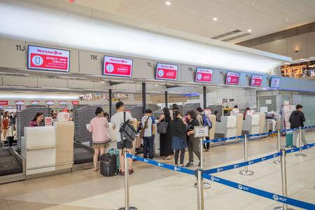 Bangkok, Thailand - April 04, 2019 : Interior with passenger check in at Thai Lion air counters in Don Mueang International Airport, Bangkok, Thailand. Publikacyjne
