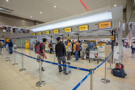 Bangkok, Thailand - April 04, 2019 : Interior with passenger check in at Nok air counters in Don Mueang International Airport, Bangkok, Thailand.