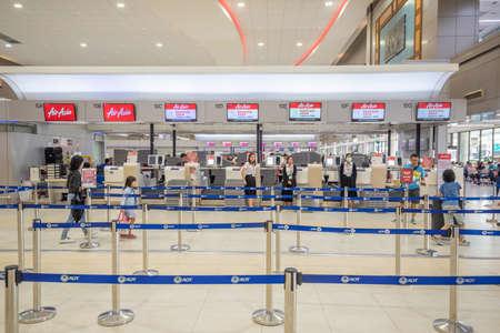 Bangkok, Thailand - April 04, 2019 : Interior with passenger check in at Airasia counters in Don Mueang International Airport, Bangkok, Thailand.