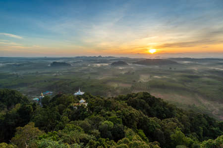 Landscape of beautiful morning fog sunrise at Khao Na Nai Luang Dharma Park in Surat Thani province, Thailand