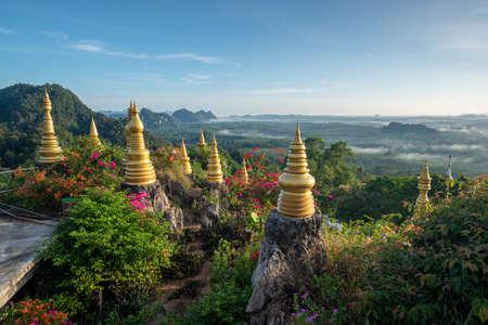 Landscape of beautiful morning fog sunrise at Khao Na Nai Luang Dharma Park in Surat Thani province, Thailand