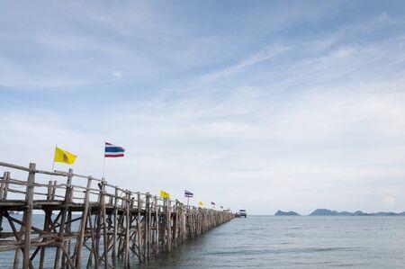 thai flag on wood bridge go to koh tao photo