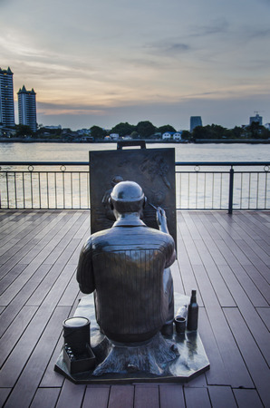 riverfront: Artist Drawing Statue Editorial